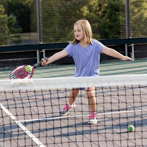4 year old girl playing platform tennis
